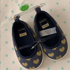 Carter's navy and gold baby shoes